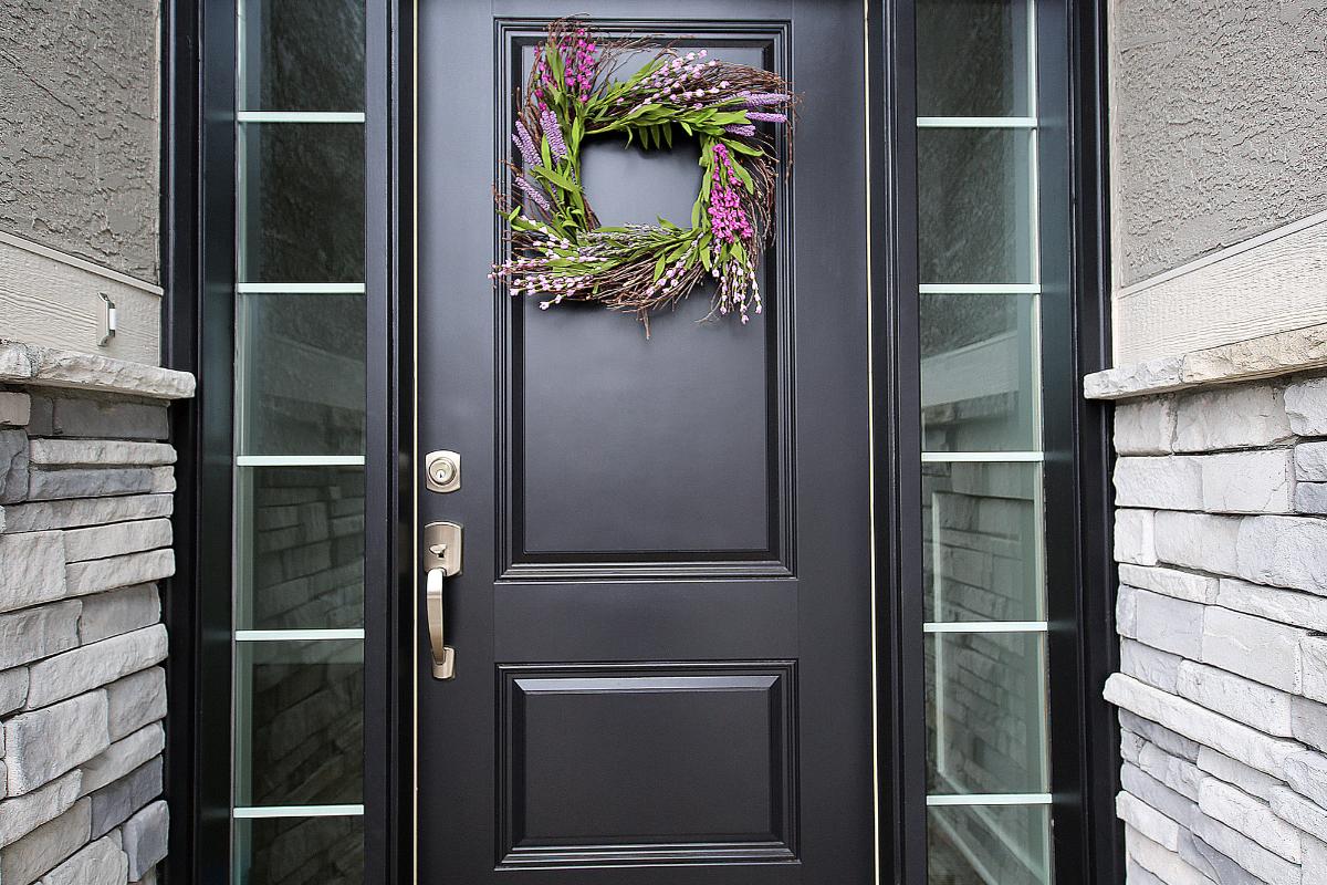 Front door of home with modern door hardware